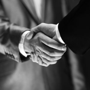 Business-handshake-contract-grey